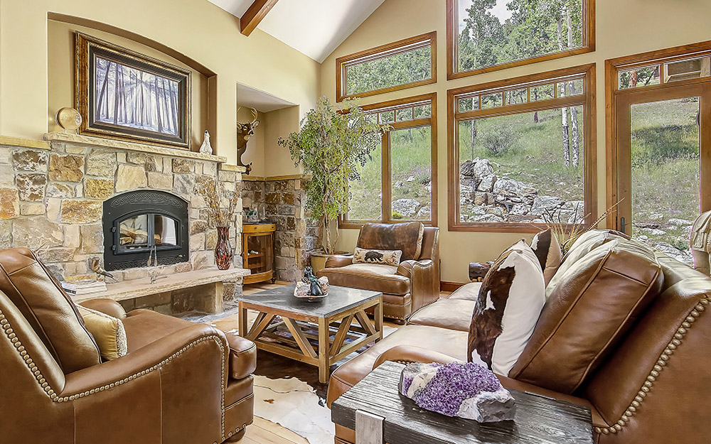 Rockies mountain home with rock fireplace